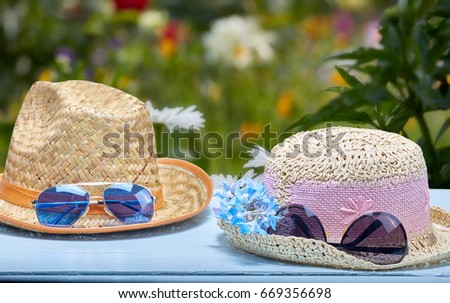 Against the background of nature, two hats and glasses