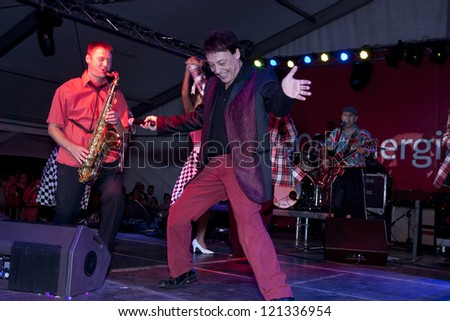 AGARD, HUNGARY - SEPTEMBER 5: Miklos Fenyo, a Hungarian rock and roll star and his band perform on the stage of Agard Pop Beach on September 5, 2009 in Agard, Hungary. The artist is 65 years old.