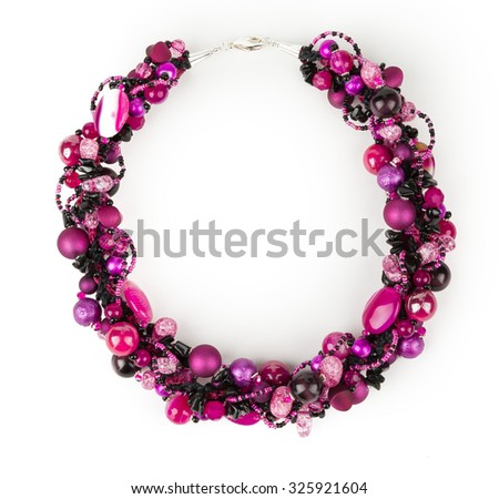 Agate, quartz, and chalcedony necklace on white background. - stock photo