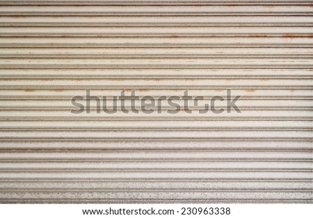 Aged And Weathered Steel Shutter Door With Rust and Dirt. - stock photo