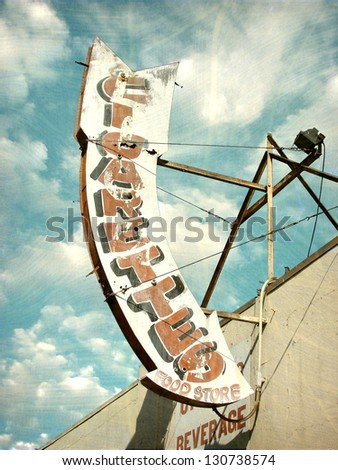aged and worn vintage arrow sign - stock photo