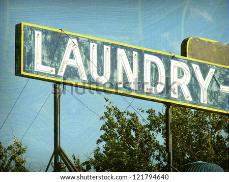aged and worn vintage laundry sign - stock photo