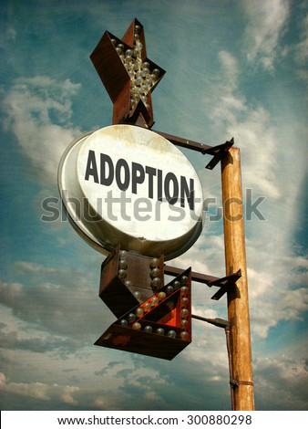 aged and worn vintage photo of  adoption sign                              - stock photo