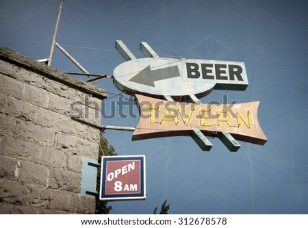 aged and worn vintage photo of beer tavern neon sign - stock photo