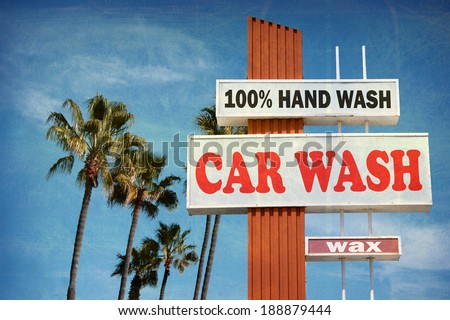 aged and worn vintage photo of car wash sign with palm trees - stock photo