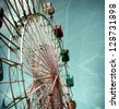 aged and worn vintage photo of carnival ferris wheel - stock photo