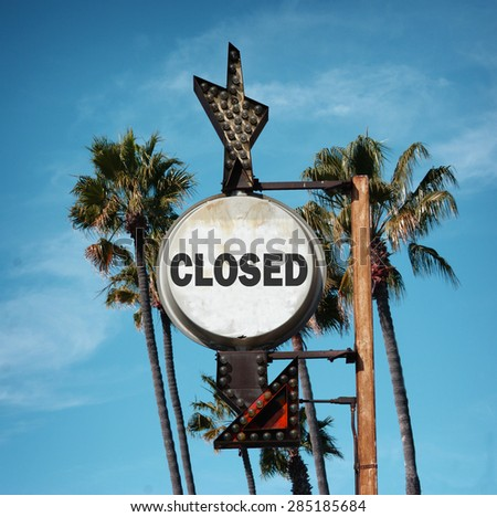 aged and worn vintage photo of closed sign and palm trees                              - stock photo