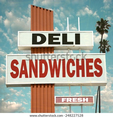 aged and worn vintage photo of deli sandwiches sign                             - stock photo
