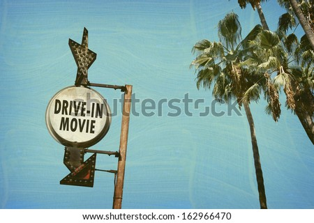 aged and worn vintage photo of drive in movies sign - stock photo