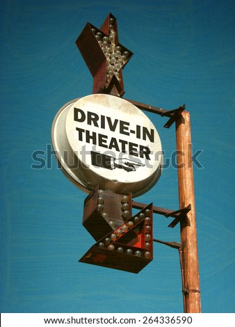 aged and worn vintage photo of drive in theater sign                               - stock photo