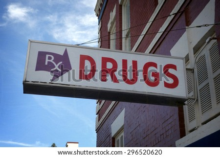 aged and worn vintage photo of drugs sign on old building                               - stock photo