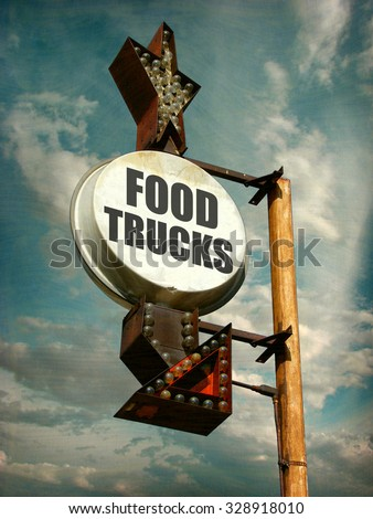 aged and worn vintage photo of food trucks sign                      - stock photo
