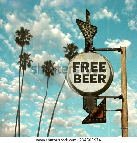 aged and worn vintage photo of free beer sign                               - stock photo