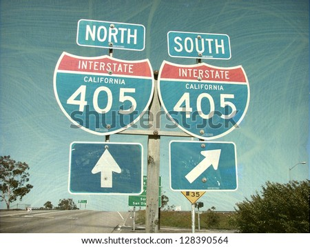 aged and worn vintage photo of freeway sign - stock photo