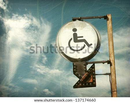 aged and worn vintage photo of  handicap sign - stock photo