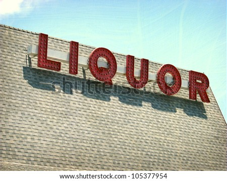 aged and worn vintage photo of liquor sign on roof - stock photo