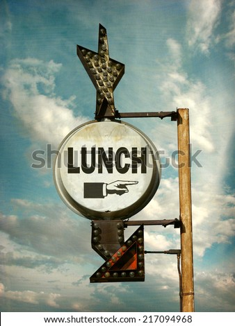 aged and worn vintage photo of lunch sign with arrow                              - stock photo