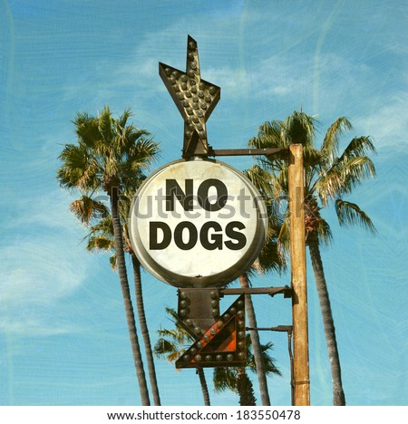 aged and worn vintage photo of no dogs allowed sign - stock photo