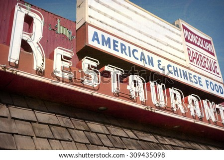 aged and worn vintage photo of old neon restaurant sign - stock photo