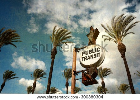 aged and worn vintage photo of public transit sign with palm trees                               - stock photo