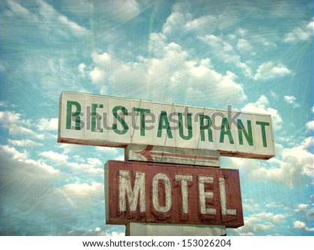 aged and worn vintage photo of restaurant and motel sign                                - stock photo