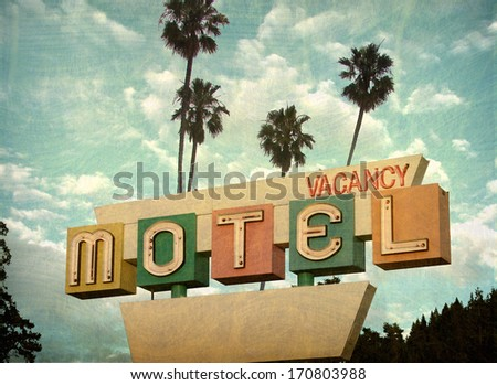 aged and worn vintage photo of  retro motel sign with palm trees                    - stock photo