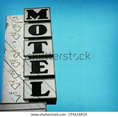 aged and worn vintage photo of retro motel sign with room for text - stock photo
