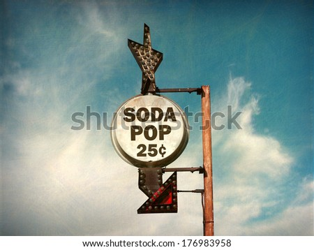 aged and worn vintage photo of retro soda pop sign                                - stock photo