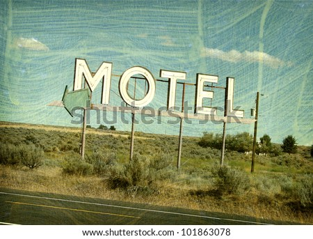 aged and worn vintage photo of roadside motel sign - stock photo