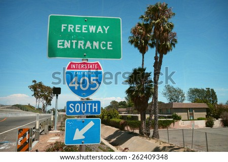 aged and worn vintage photo of southern california freeway sign                                - stock photo