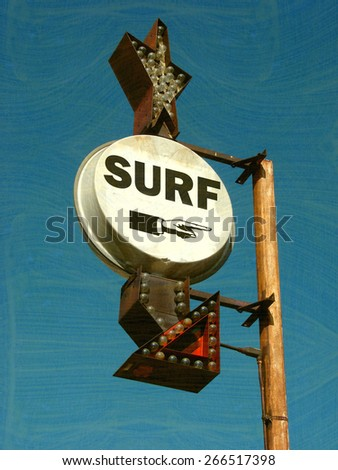 aged and worn vintage photo of surf sign                              - stock photo