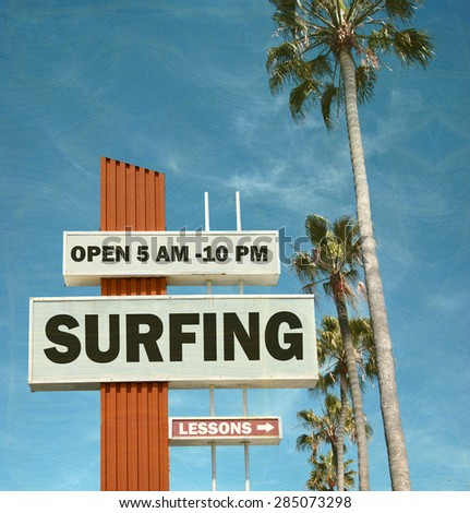 aged and worn vintage photo of surfing sign and palm trees - stock photo