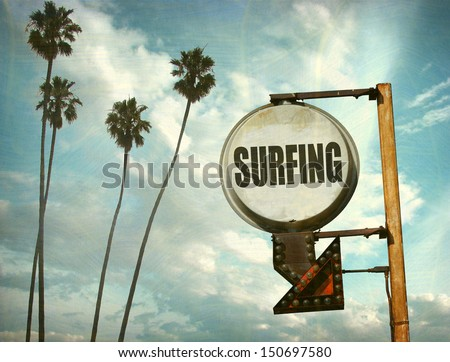 aged and worn vintage photo of surfing sign with palm trees - stock photo
