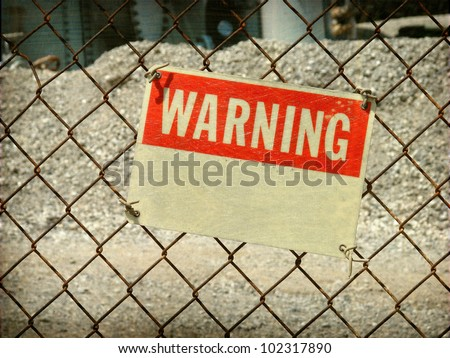 aged and worn vintage photo of  warning sign on fence - stock photo