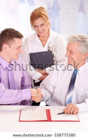Aged and young guy, working in very different fields of activity - stock photo