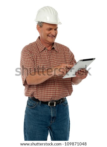Aged architect working on tablet pc isolated over white background - stock photo