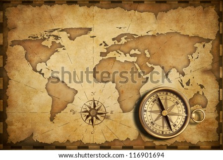 aged brass antique nautical pocket compass with old map - stock photo