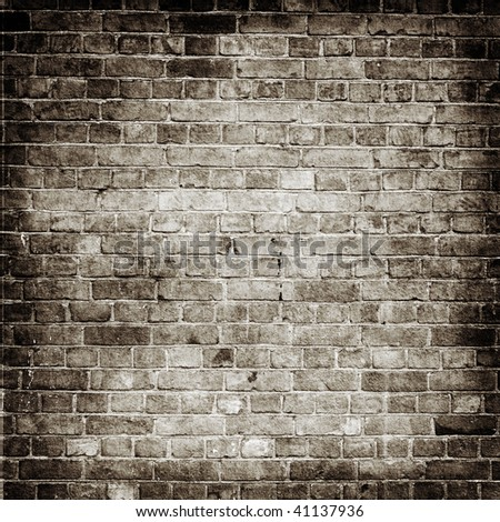 Aged brick wall texture - stock photo