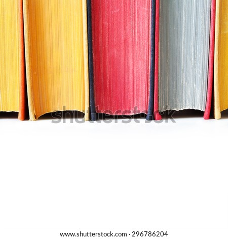 Aged colorful book spines. Close up, texture, hard cover. White background. Copy space. - stock photo