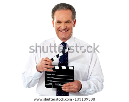 Aged corporate male holding clapperboard. Shot on white background - stock photo