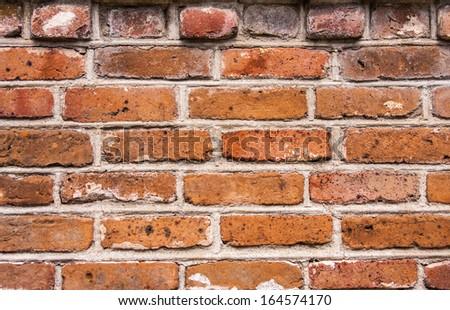 Aged decorative brick wall background - stock photo