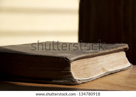 Aged dusty book - stock photo