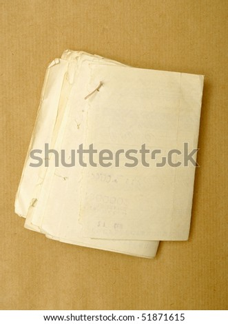 aged heap of paper over brown cardboard background