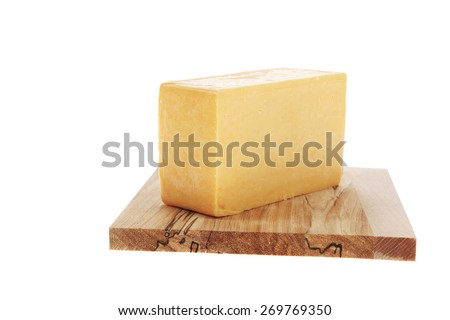 aged italian deli fresh cheddar cheese served on wooden cutting plate isolated over white background - stock photo