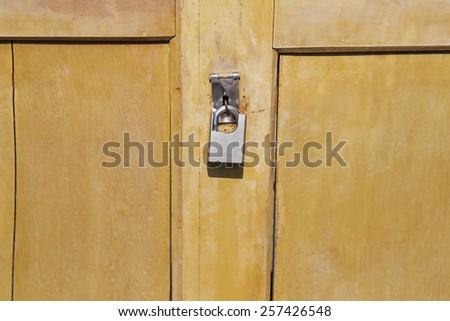 aged lock locked the door - stock photo