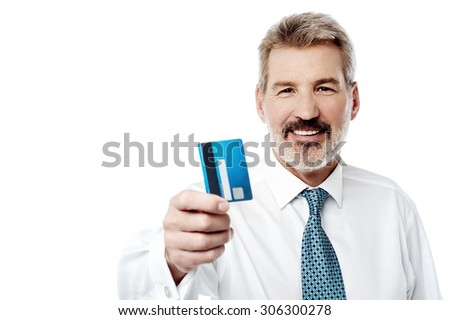 Aged male executive offering his credit card