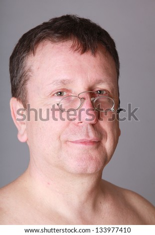 Aged man portrait with glasses