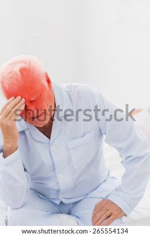 Aged man suffering while woman sleeping on the bed - stock photo
