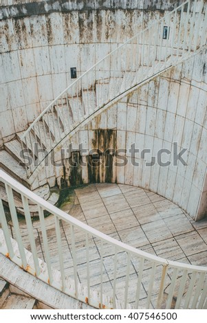 Aged marble sandstone concrete ladder stairs with handrail.
