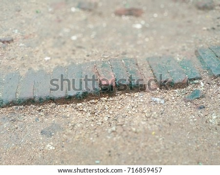 aged/old Bricks in a row on floor surface